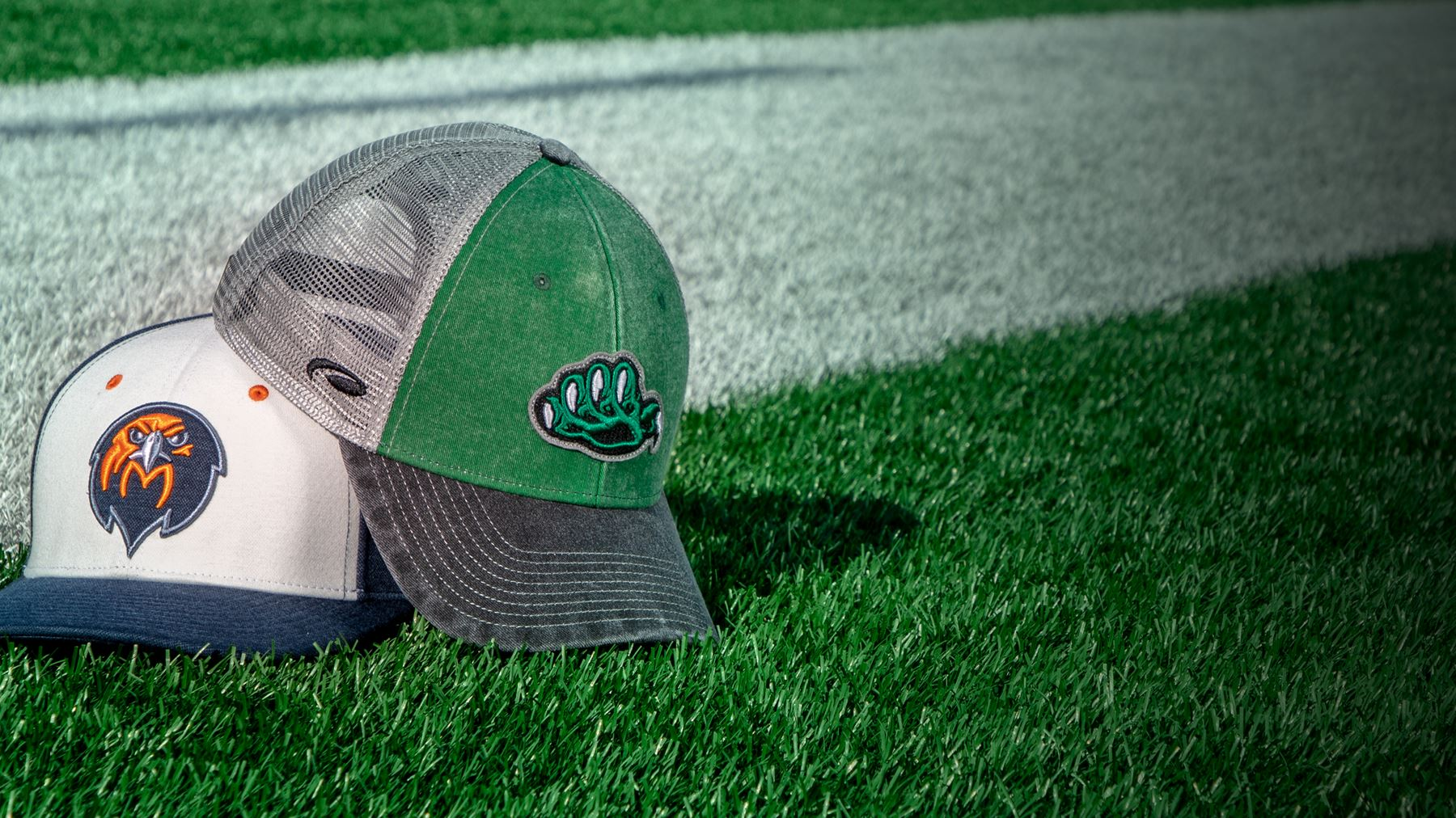 New Releases hats sitting on a football field