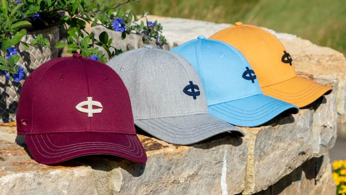 Golf hats sitting on stone wall
