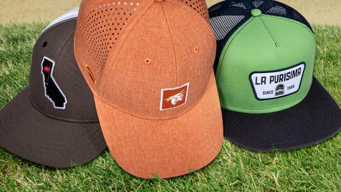 A group of Popular Look hats on a golf course