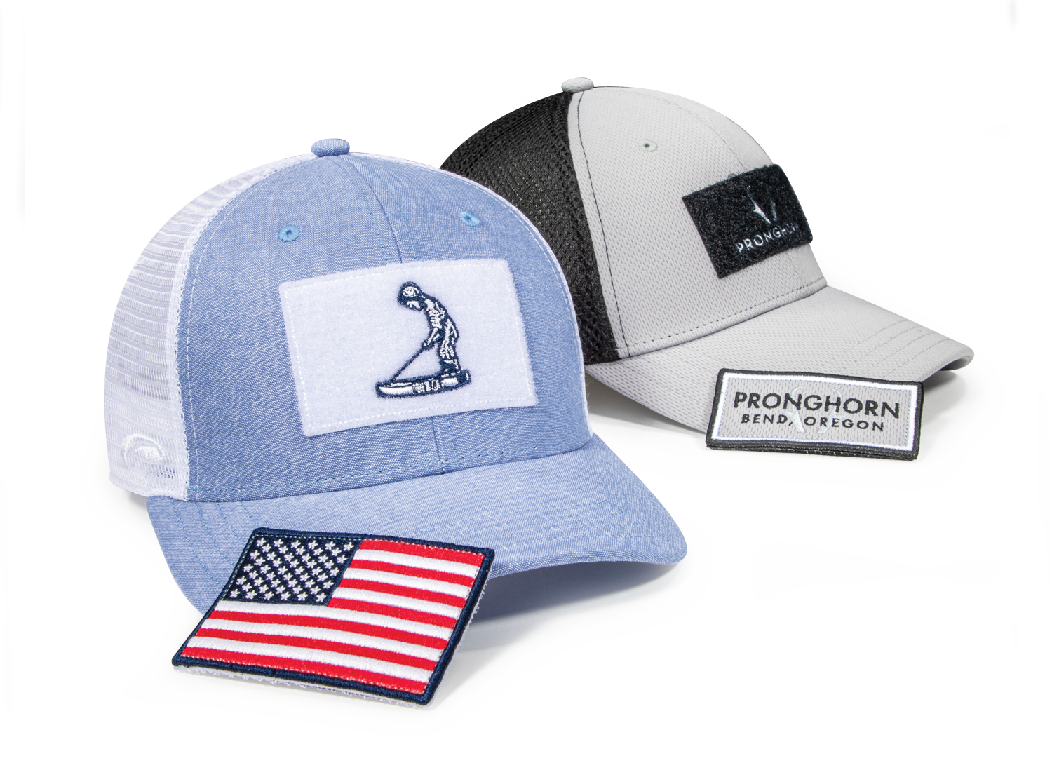 A pair of golf hats with removable top patch custom appliques