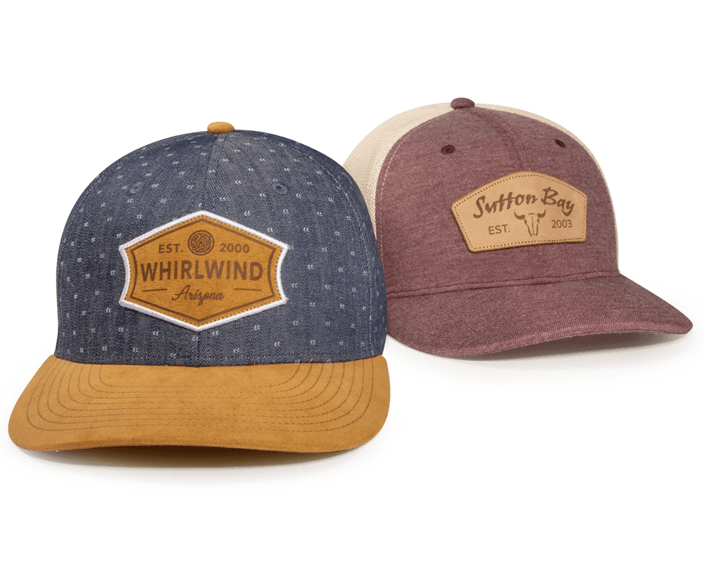 A pair fo golf hats with Laster Etched Patches
