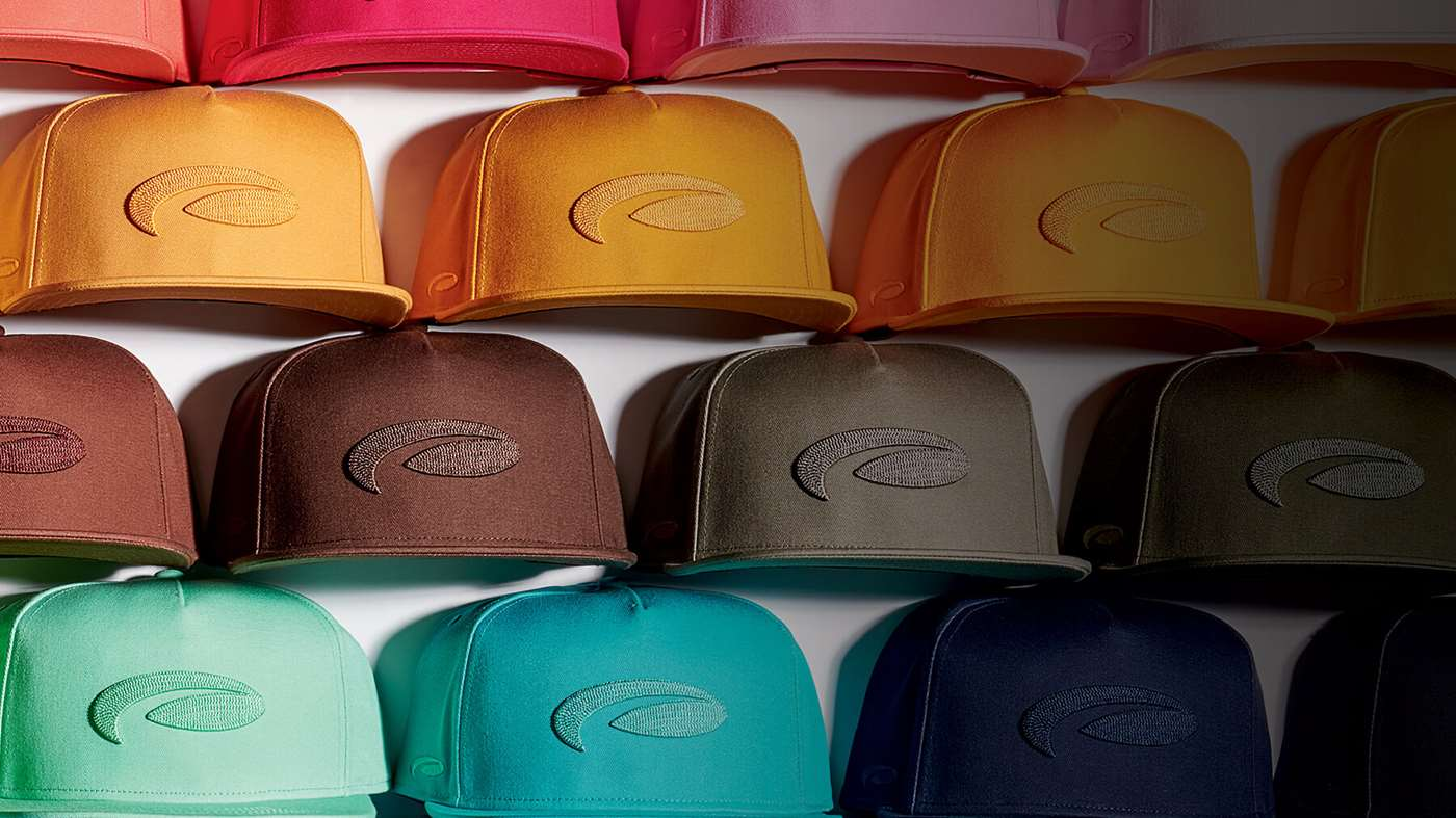 Hats of many colors stacked up