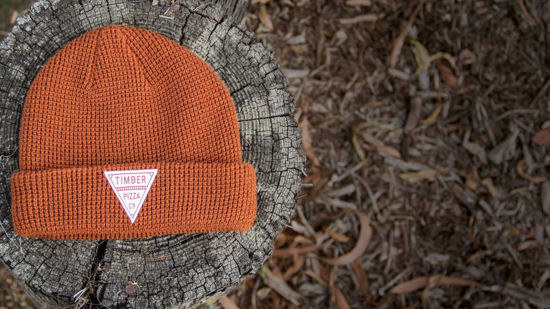 Wheelhouse / Waffle Knit hat laying on tree stump