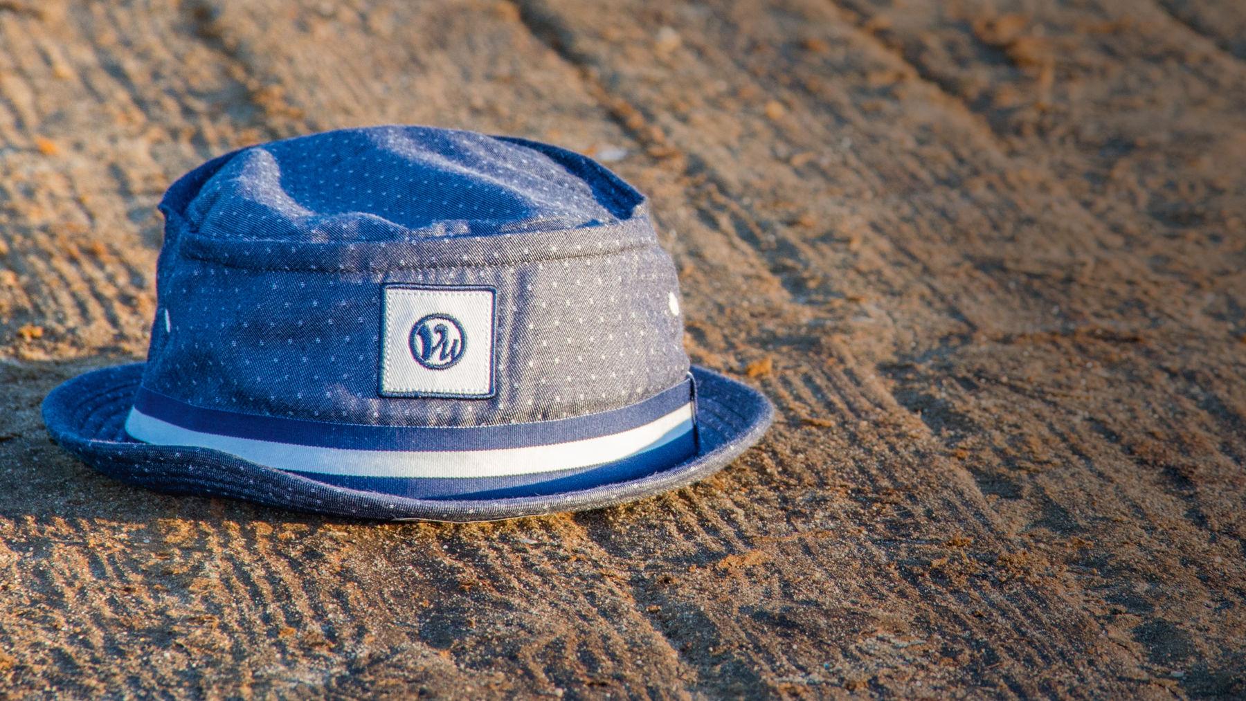 75083fae0950 Reilley bucket hat sitting on sand