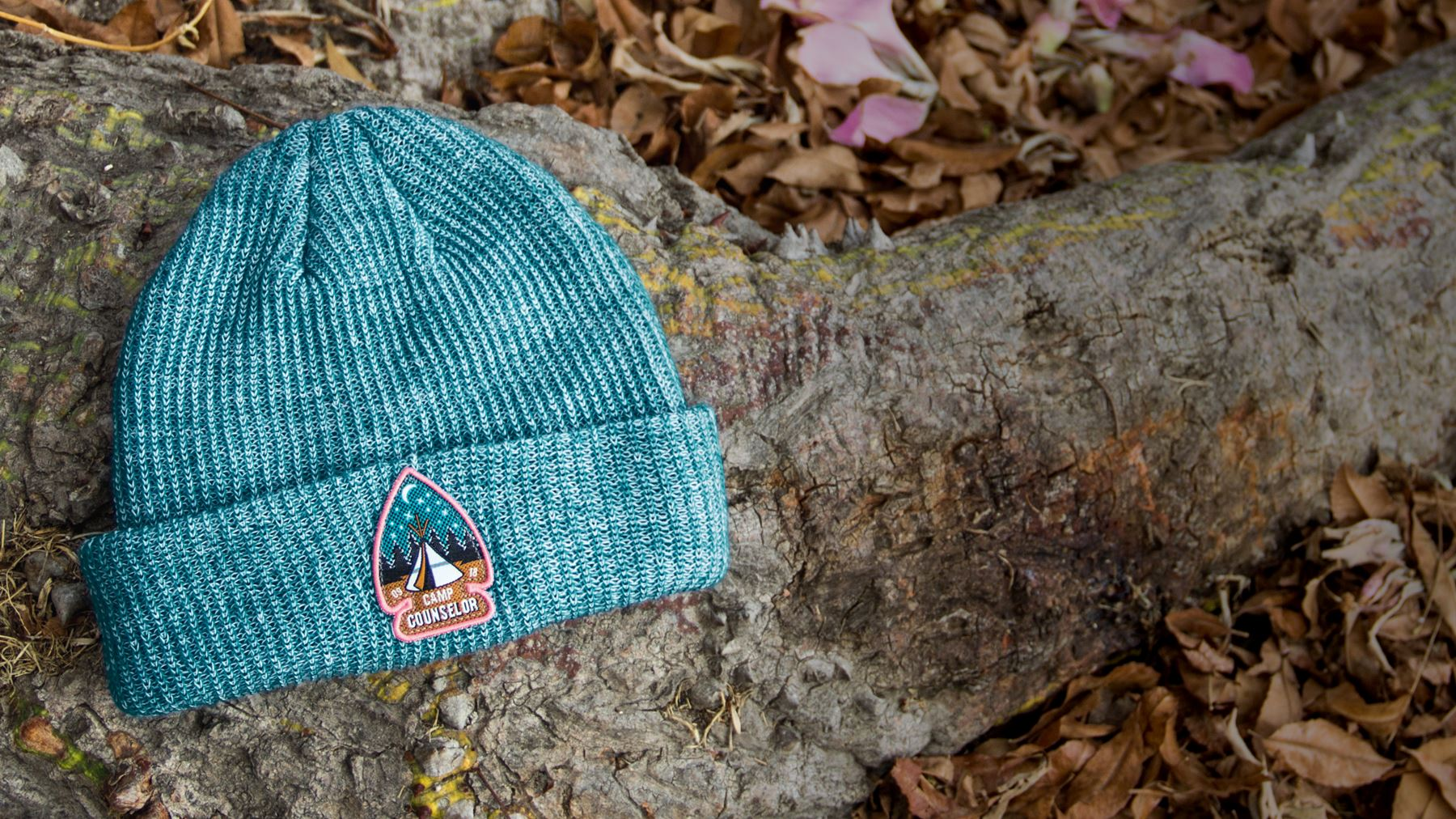 Compass knit hat laying on stone